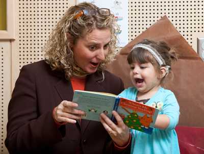 a teacher reading to a child